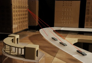 "Featured in the exhibition ""Single Bullet,"" this model of Dealey Plaza was created by architecture students at Philadelphia University to show the bullet trajectories proposed in Arlen Specter's ""Single Bullet"" theory. Photo: Henry W. Thomas."